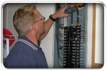 Vocational student learns air conditioning repair from an experienced instructor.